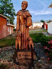 St. Francis- carved into a tree stump